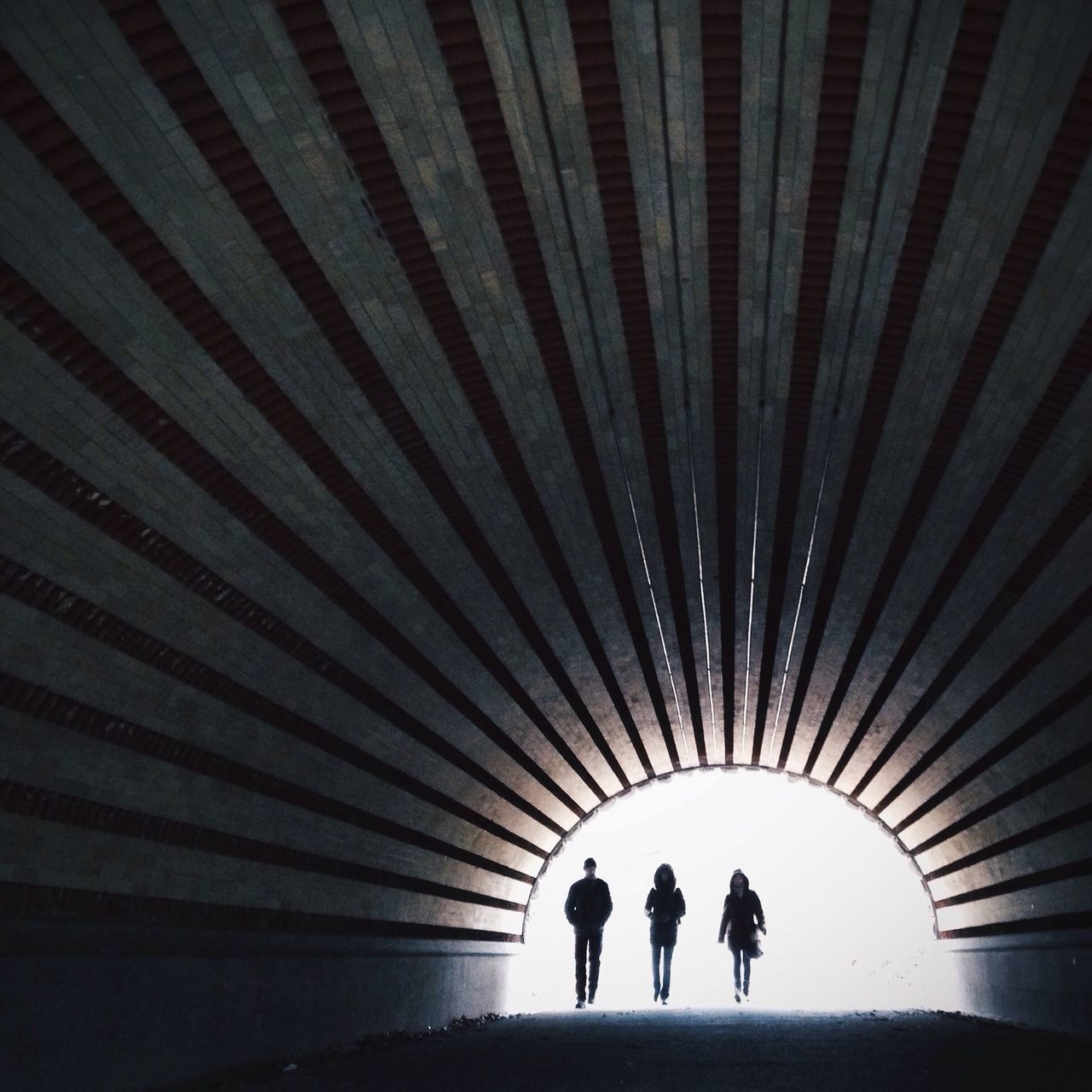 Full Length Of People Walking In Tunnel