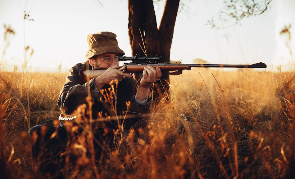 Beautiful stock photos of grass, 54-59 Years, Accuracy, Adventure, Aiming