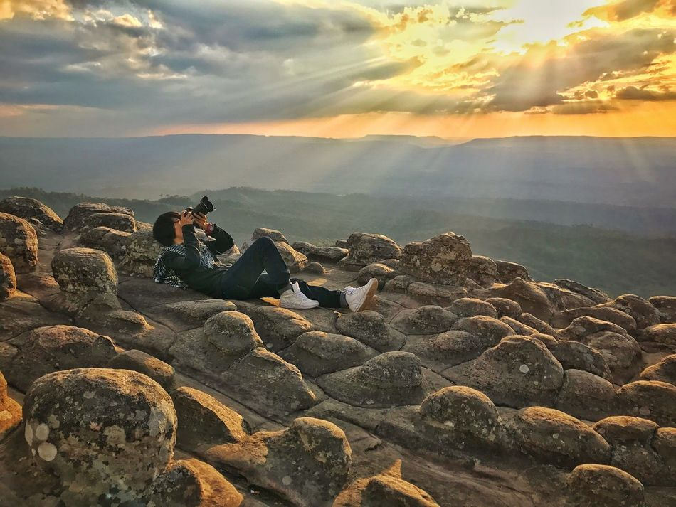 EyeEmNewHere Sky Nature Beauty In Nature Rock - Object Cloud - Sky Sunset Outdoors Scenics Tranquil Scene One Person Sun Camera Take Photos Thailand Sunlight Real People Travel Tourist Tourism National Park Shot Waiting Chilling Relaxing Miles Away Uniqueness