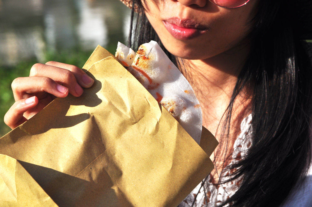 Girl eating street food in Hoi An, Vietnam. Close-up Eating Hands Hoi An Mouth Outdoors Pancakes Paper Bags Street Streetfood Tourism Vietnam Women Young Adult