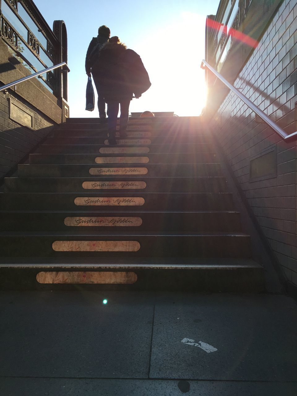 steps and staircases, steps, staircase, full length, real people, one person, rear view, railing, low angle view, sunlight, men, standing, walking, built structure, lifestyles, architecture, stairs, leisure activity, day, indoors, sky, one man only, adult, people