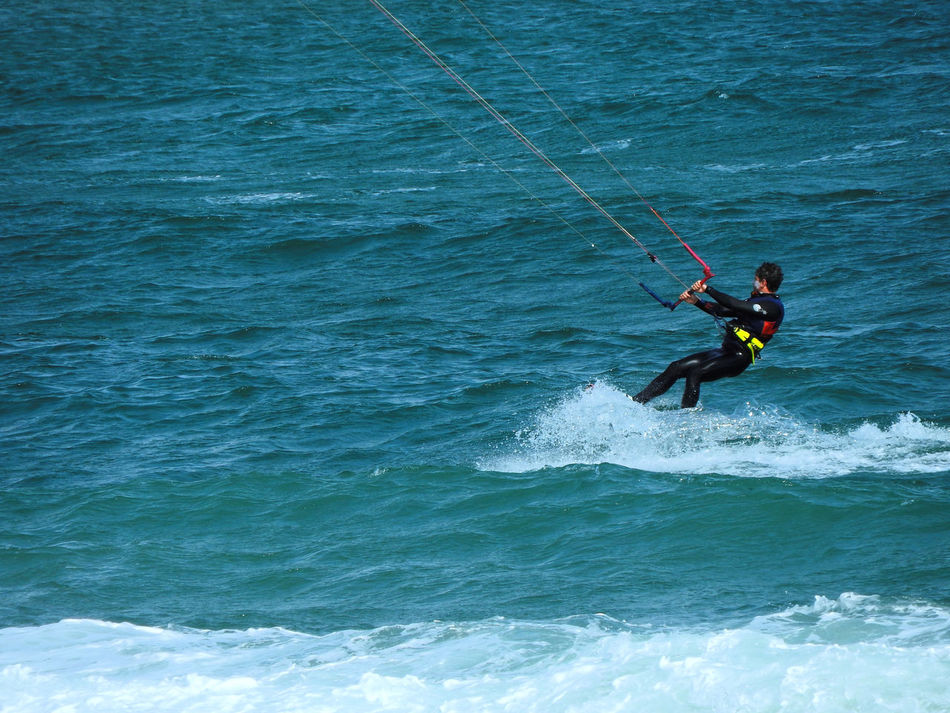 Activity Adventure Extreme Sports Having Fun Man One Person Outdoors Sea Sea And Sky Sea Life Seascape Sport Strong Wind Surfer Surfing Vitality Water Water Sport Waterfront Wave Waves Waves Splashing Wind Wind Surf Windsurfing