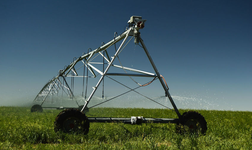 Irrigation pivot Agriculture Clear Sky Day Farming Circle Grass Growth Irrigation Equipment Landscape Machinery Near Lusk Wyomin Outdoors