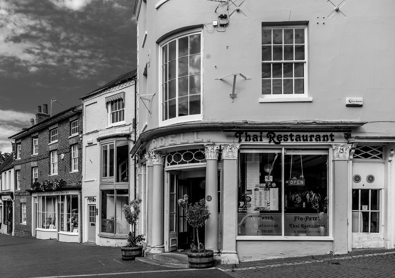 Odell's and the High Street, Newport Pagnell, Buckinghamshire Architecture Black And White Monochrome Buckinghamshire Shops Newport Pagnell High Street