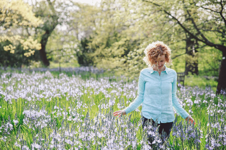 Beauty In Nature Blonde Blooming Blue Jeans Bluebells Casual Clothing Curly Hair Field Flower Flowers Focus On Foreground Fragility Girl Grass Growth Leisure Activity Lifestyles Nature Outdoors Park Plant Shirt Spring Tranquility Natural Light Portrait EyeEm LOST IN London