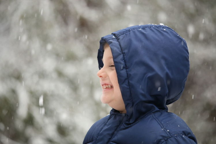 First snow! First Snow Cold Temperature White Christmas Playing Childhood New Experience Happy Fun Child EyeEm Selects Casual Clothing Cold Temperature Winter Outdoors Smiling