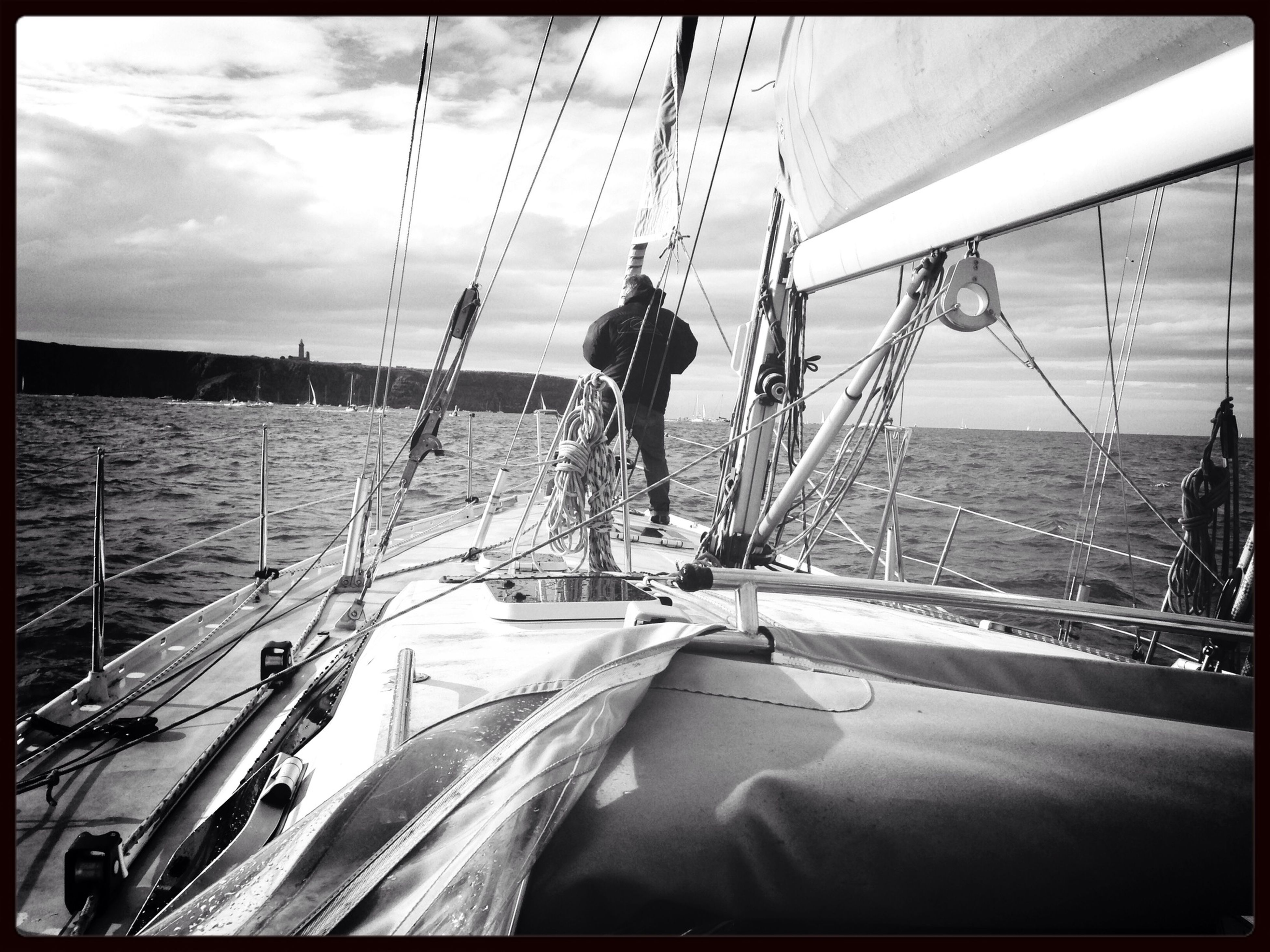 transportation, transfer print, mode of transport, sea, nautical vessel, sky, water, auto post production filter, boat, horizon over water, travel, mast, men, beach, moored, cloud - sky, sailboat, day