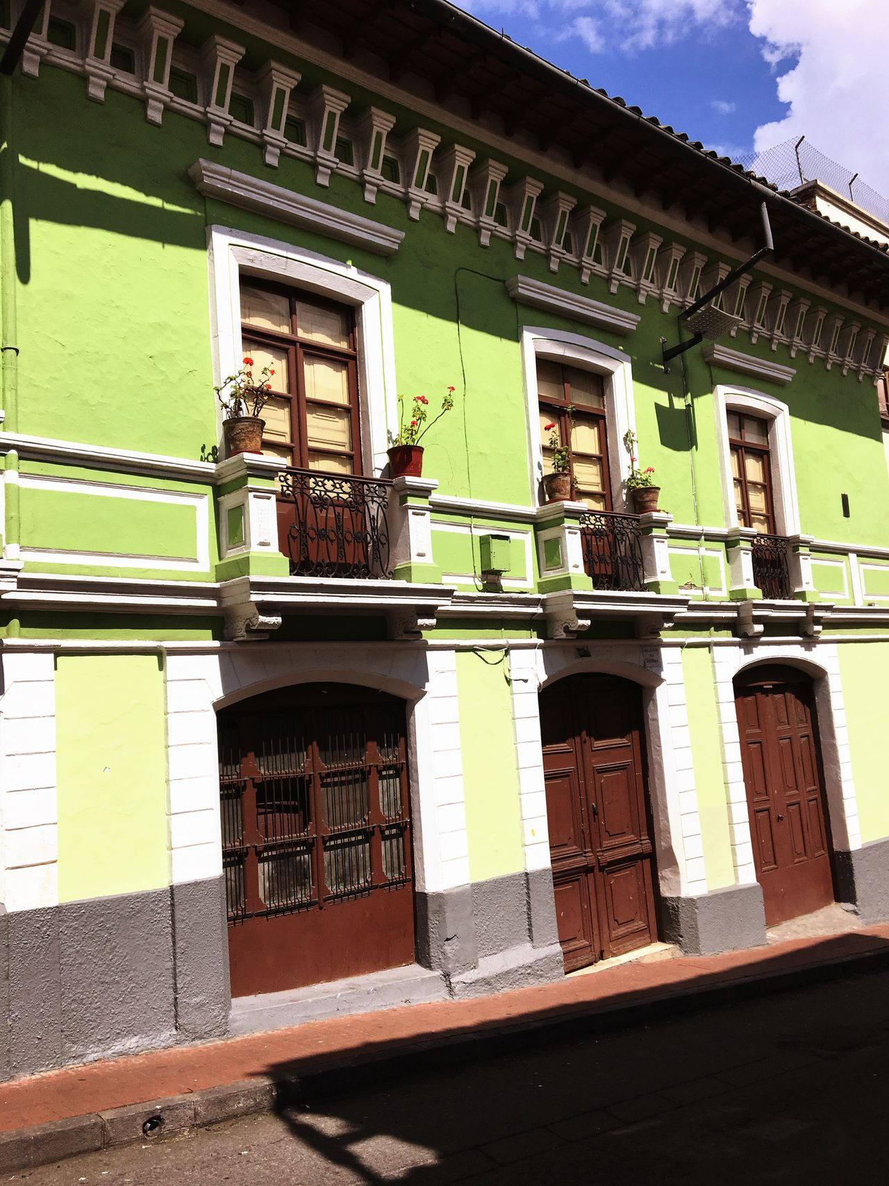Green buildings Roses Angle Slant Building Exterior Architecture Built Structure Window Let's Go. Together. Built_Structure Quito South America Equador EyeEmNewHere City Town Outdoors Day EyeEmNewHere Let's Go. Together.