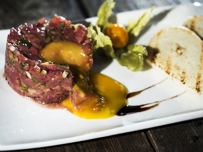 Raw steak tatar with egg yolk Appetizer Close-up Day Egg Food Food And Drink Freshness Healthy Eating Indoors  Indulgence Meat No People Plate Raw Ready-to-eat Serving Size SLICE Steak Still Life Table Tatar Temptation Yolk