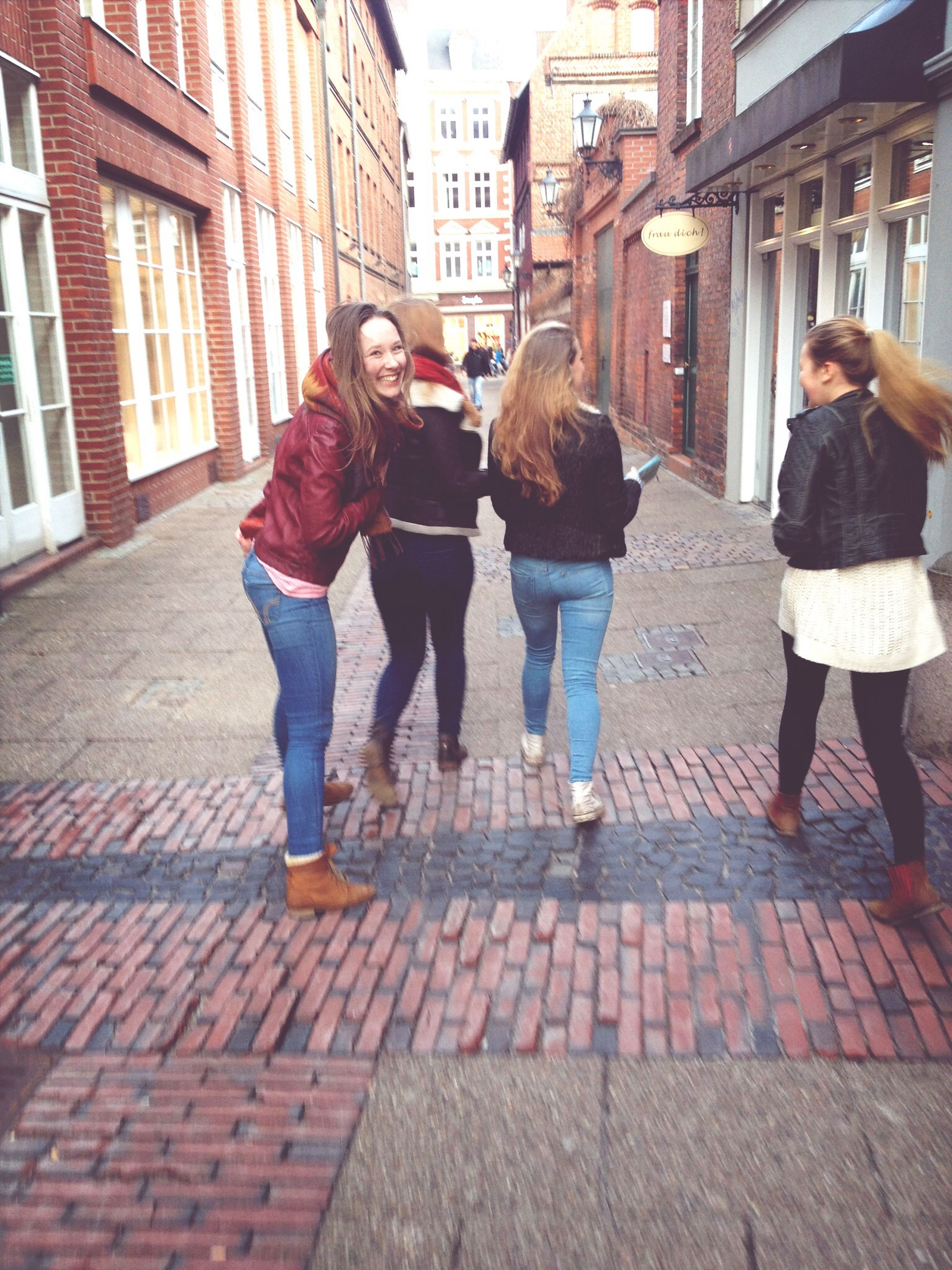 building exterior, lifestyles, architecture, built structure, full length, leisure activity, togetherness, casual clothing, bonding, city, men, city life, friendship, young men, love, walking, standing, person