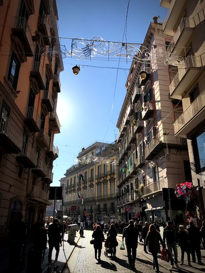 Napoli, via Toledo Building Exterior Architecture Large Group Of People Built Structure Real People Men Walking City Outdoors Sky Women Low Angle View Day Adults Only People Adult Vicolidiquestacitta Vicoli Di Napoli Napoliphotoproject