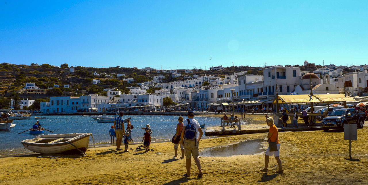 Mykonos,Greece Adult Architecture Beach Blue Building Exterior Built Structure Clear Sky Day Go-west-photography.com Greece Kyklades Kyklades Islands Moored Mykonos Nature Nautical Vessel Outdoors People Real People Sea Sky Sunlight Travel Destinations Water