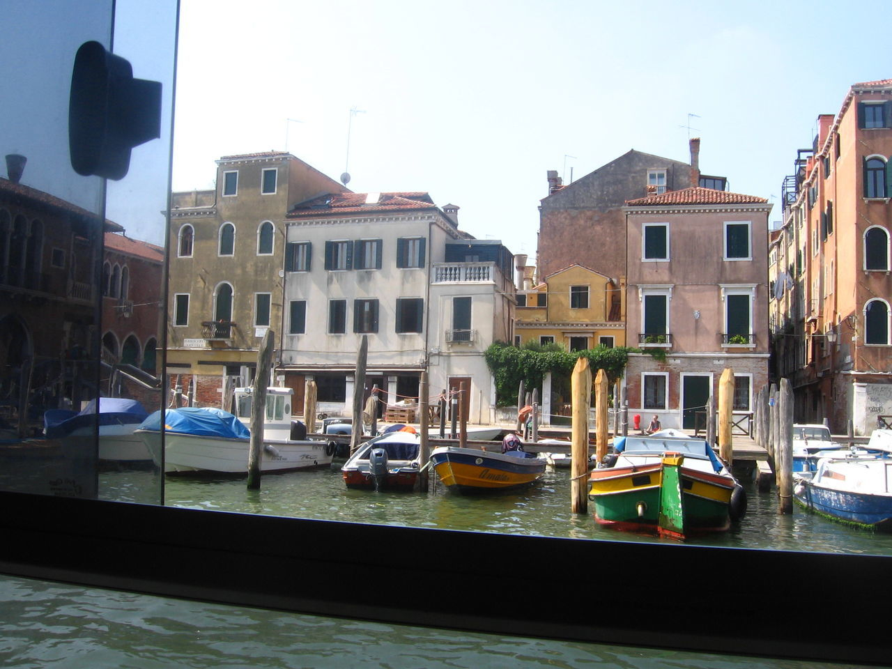 Boats On Canal Against Buildings In City