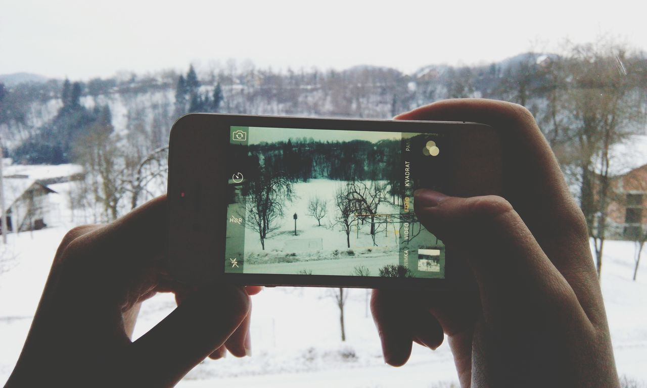 Smart Phone Photographing Technology Device Screen Human Hand Human Body Part Digital Viewfinder Wireless Technology Winter Snow ❄ Trees