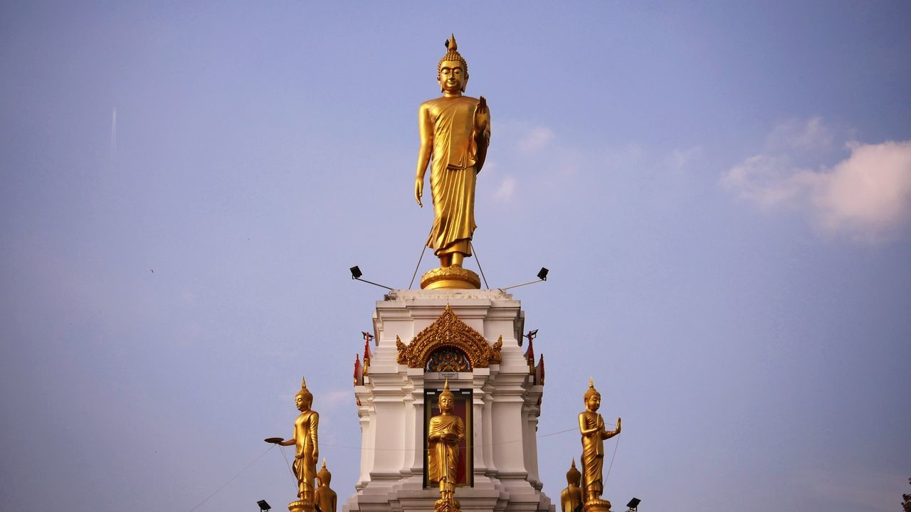 statue, human representation, sculpture, male likeness, religion, gold colored, art and craft, spirituality, golden color, low angle view, gold, golden, no people, architecture, outdoors, place of worship, sky, day