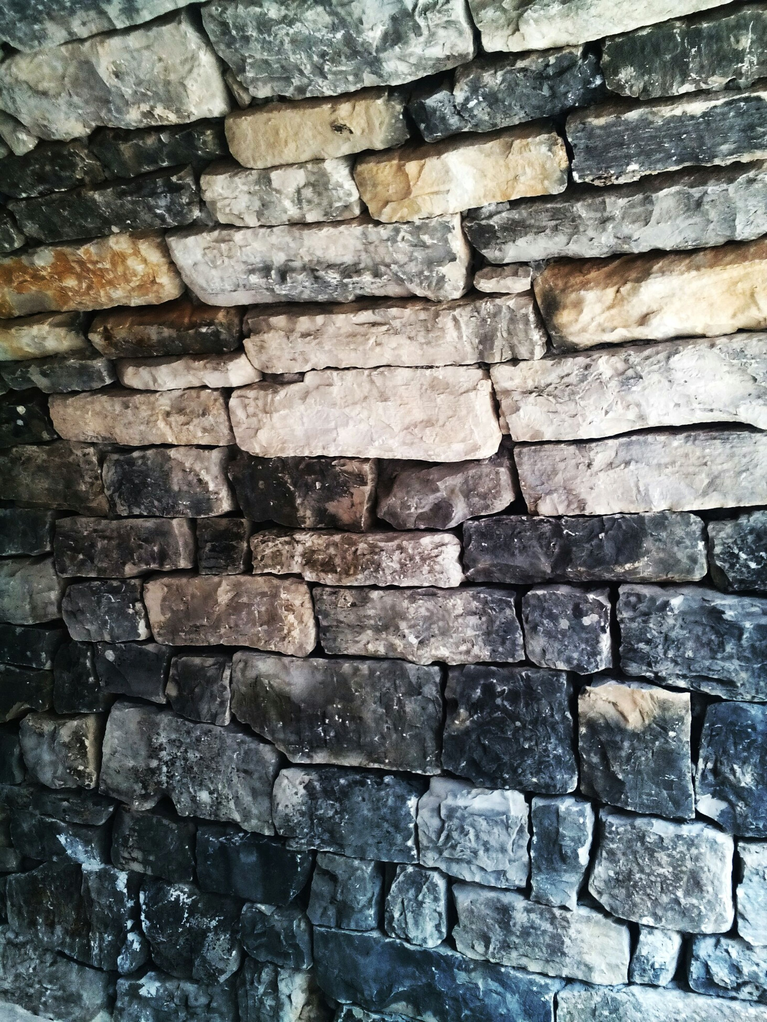 full frame, backgrounds, brick wall, textured, pattern, stone wall, wall - building feature, cobblestone, brick, rough, built structure, close-up, architecture, no people, outdoors, day, paving stone, detail, wall, stone material