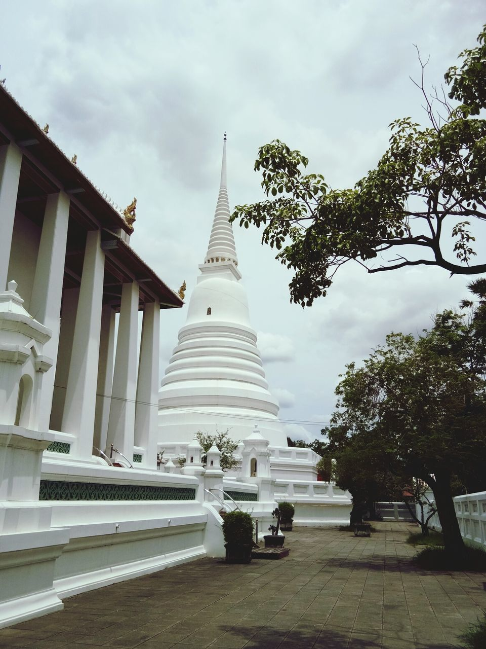 architecture, religion, built structure, spirituality, place of worship, tree, building exterior, sky, day, cloud - sky, outdoors, no people, travel destinations, statue, sculpture, nature