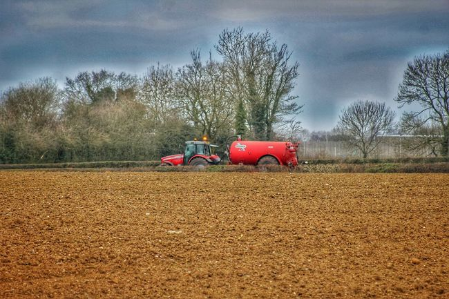 Landscapes With WhiteWall Muddy Field Spring Is Here Tractor Tractor And Trailer Red Tractor HDR EyeEm Nature Lover EyeEm Best Edits Well Turned Out EyeEm Best Shots EyeEm Gallery Our Best Pics EyeEm Best Shots - Landscape Exceptional Photographs Fields Nature_perfection Farm Life