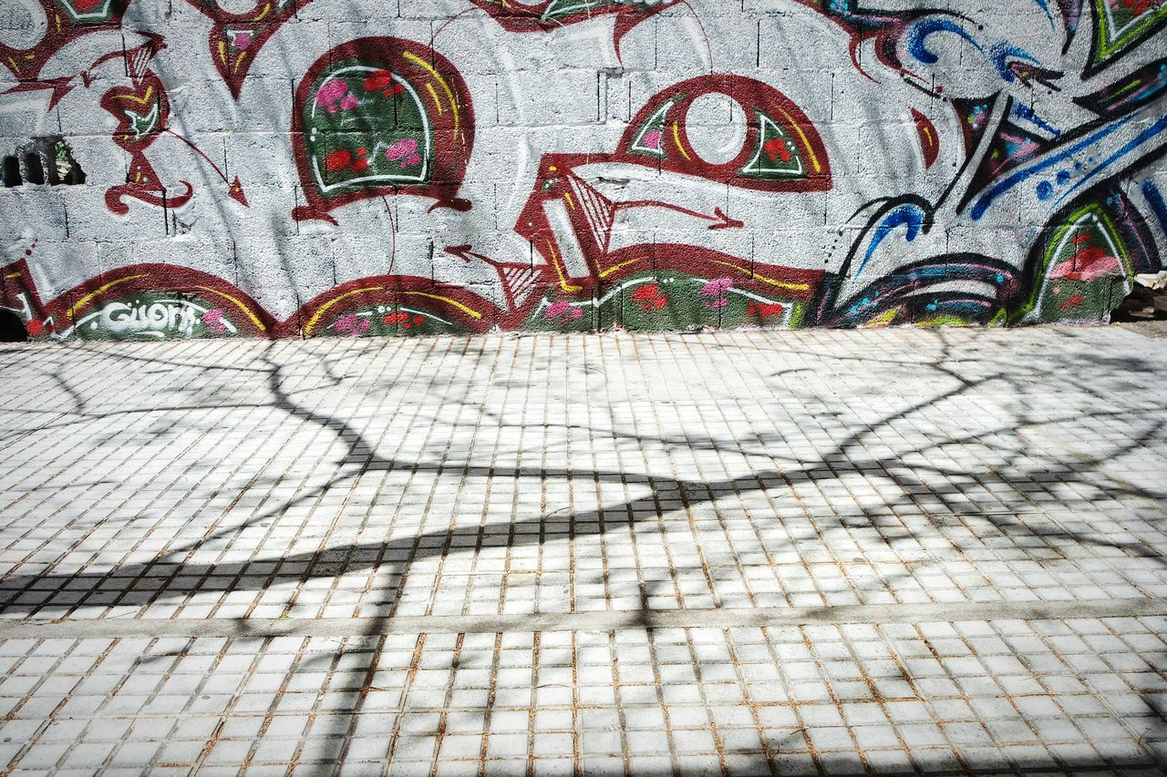 Shadows and graffiti Graffiti Day Full Frame No People Textured  Backgrounds Outdoors Architecture Close-up Light And Shadow Building Exterior Art Is Everywhere EyeEm Best Shots Fresh 3 Eye4photography  Shadows & Lights Pattern Multi Colored Creativity Graffiti Art And Craft