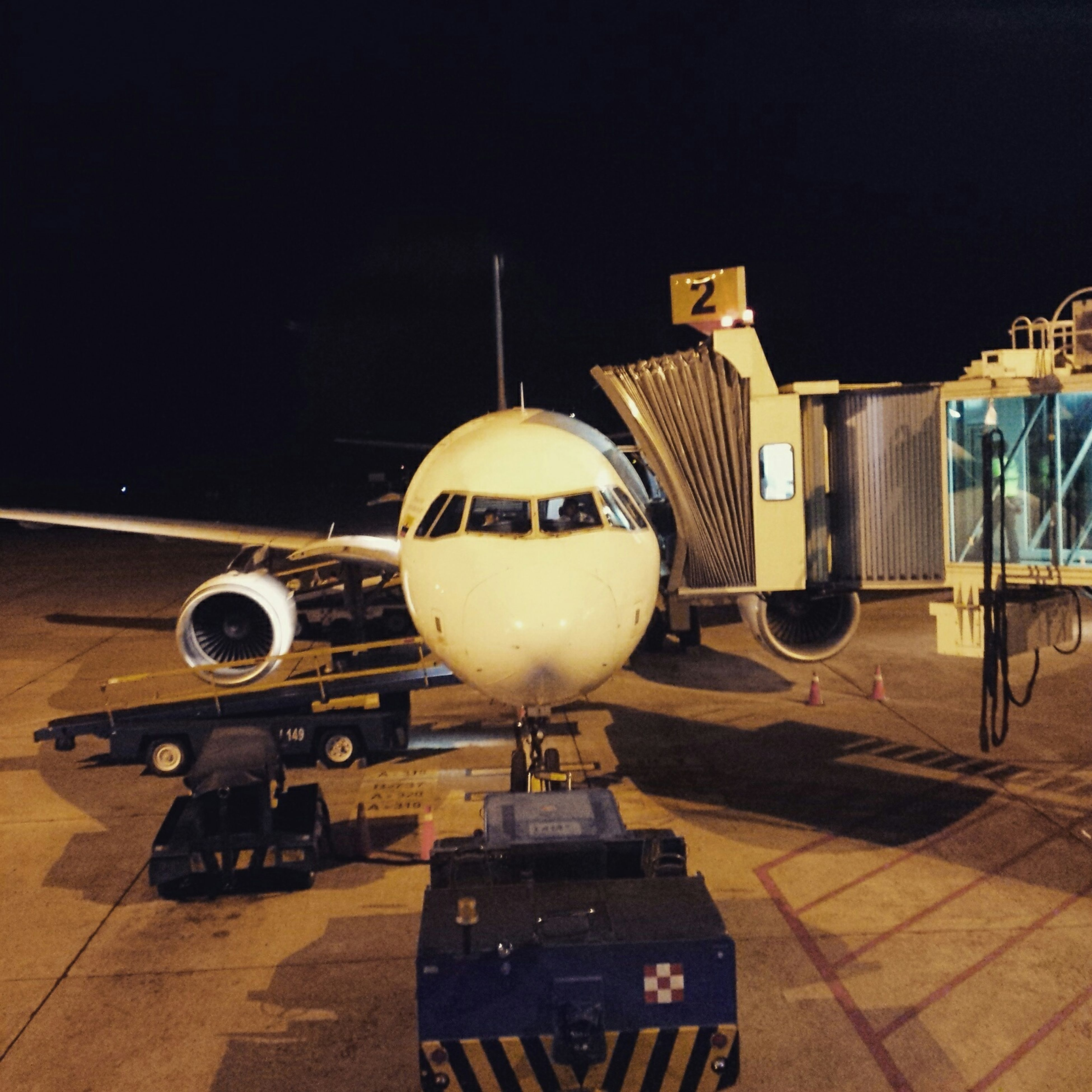 illuminated, night, architecture, transportation, built structure, lighting equipment, building exterior, city, airport, indoors, no people, copy space, modern, mode of transport, street, travel, street light, airplane, clear sky