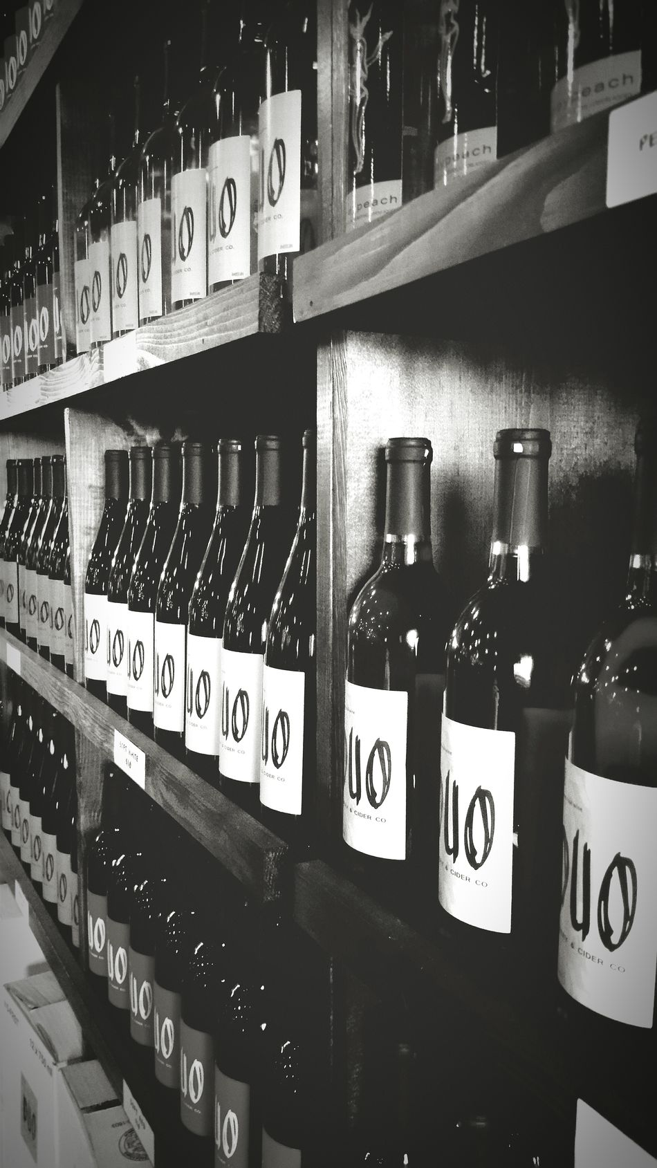 Wine Bottle Alcohol Drink Bottle In A Row No People Shelf Label Text Business Finance And Industry Alternative Medicine Wine Indoors  Liquor Store Close-up