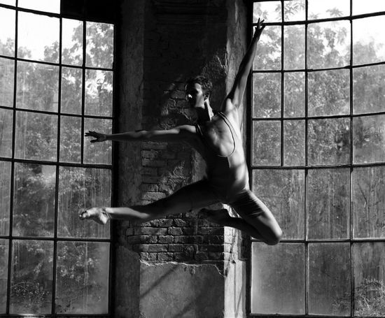 Architecture Balance Ballet Ballet Dancer Built Structure Day Exercising Flexibility Flying Full Length Indoors  Jumping Lifestyles Men One Person People Real People Shirtless Skill  Strength Young Adult