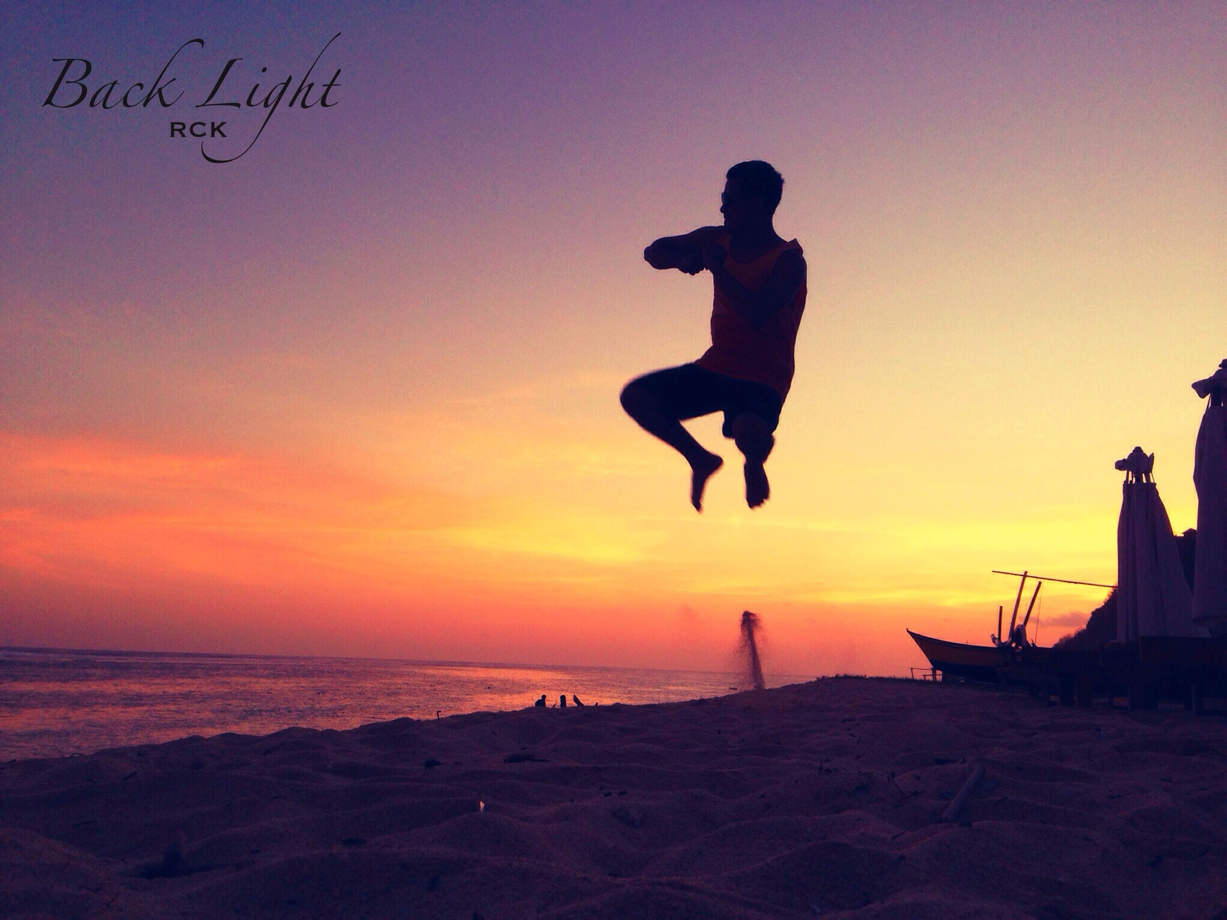 sunset, lifestyles, leisure activity, sea, beach, full length, silhouette, men, sky, water, shore, horizon over water, orange color, person, enjoyment, mid-air, vacations, standing
