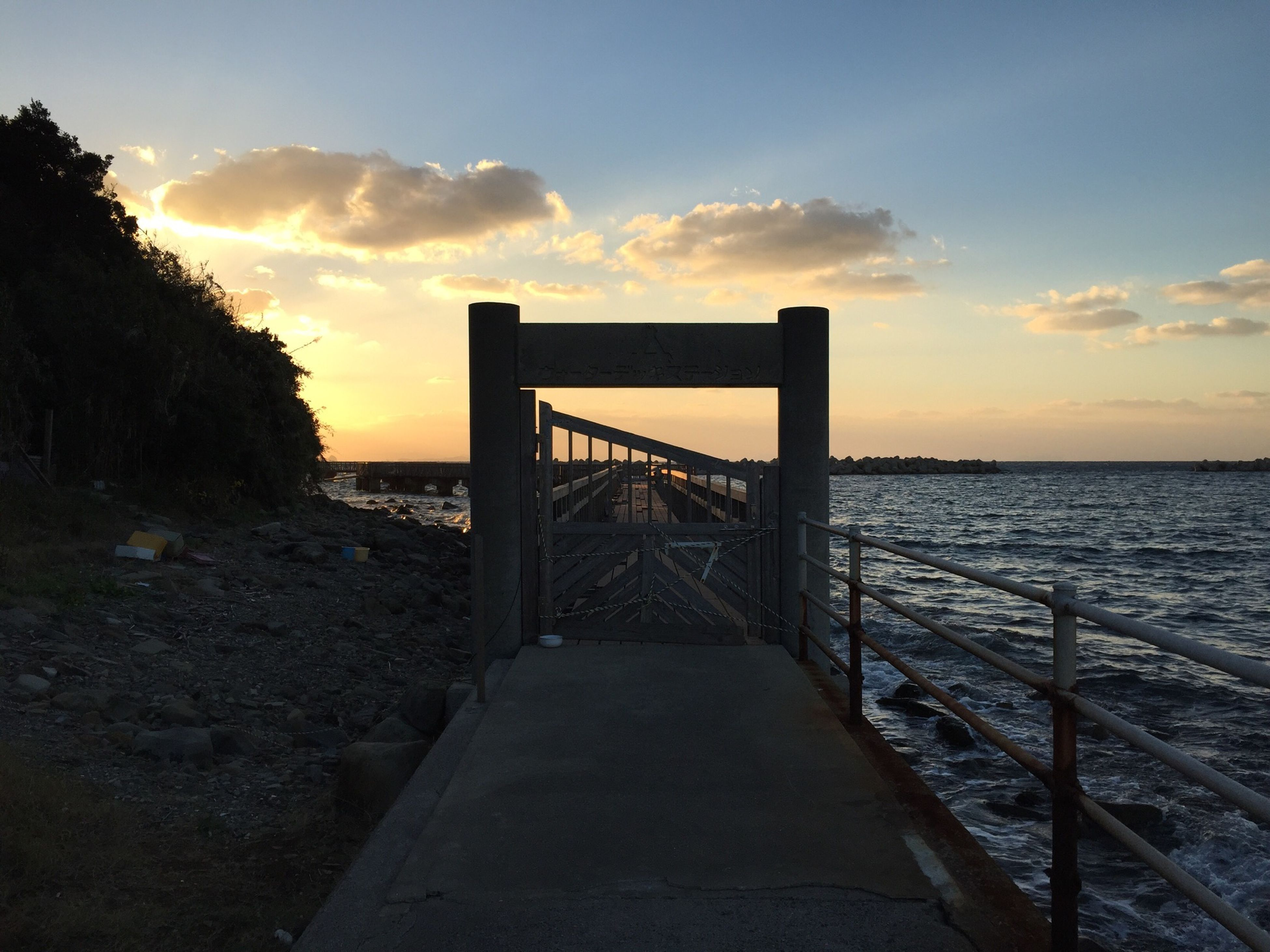 sunset, water, sea, sky, railing, tranquility, tranquil scene, scenics, beauty in nature, nature, pier, horizon over water, built structure, orange color, cloud - sky, the way forward, idyllic, connection, silhouette, dusk