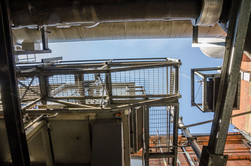 Looking up at metal ducts and a walkway. Architecture Building Exterior Built Structure Day Ducting Gantry Indoors  Industrial Metal No People Railing Walkway