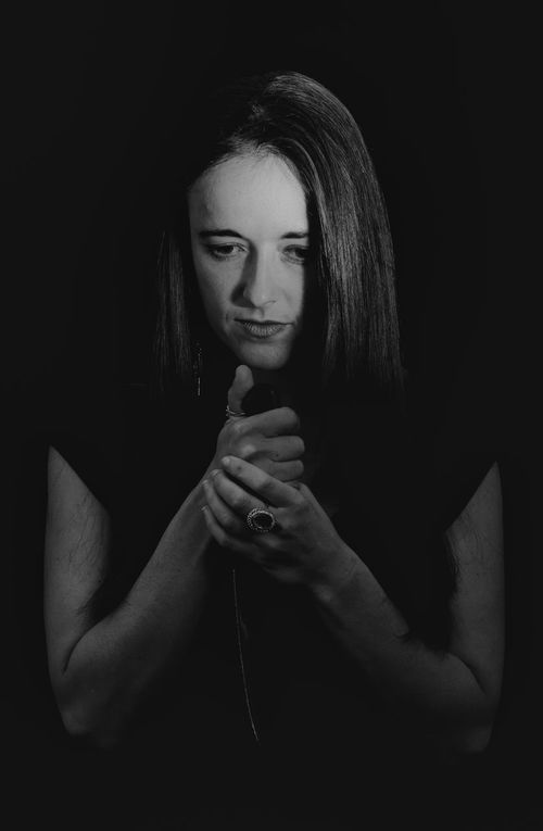 Angry Blackandwhite Casual Clothing Dark Deadly Depressed Front View Human Hair Indoors  Kill Knife Leisure Activity Lifestyles Long Hair Person Portrait Sad Straight Hair Vicious Woman Young Adult Young Women