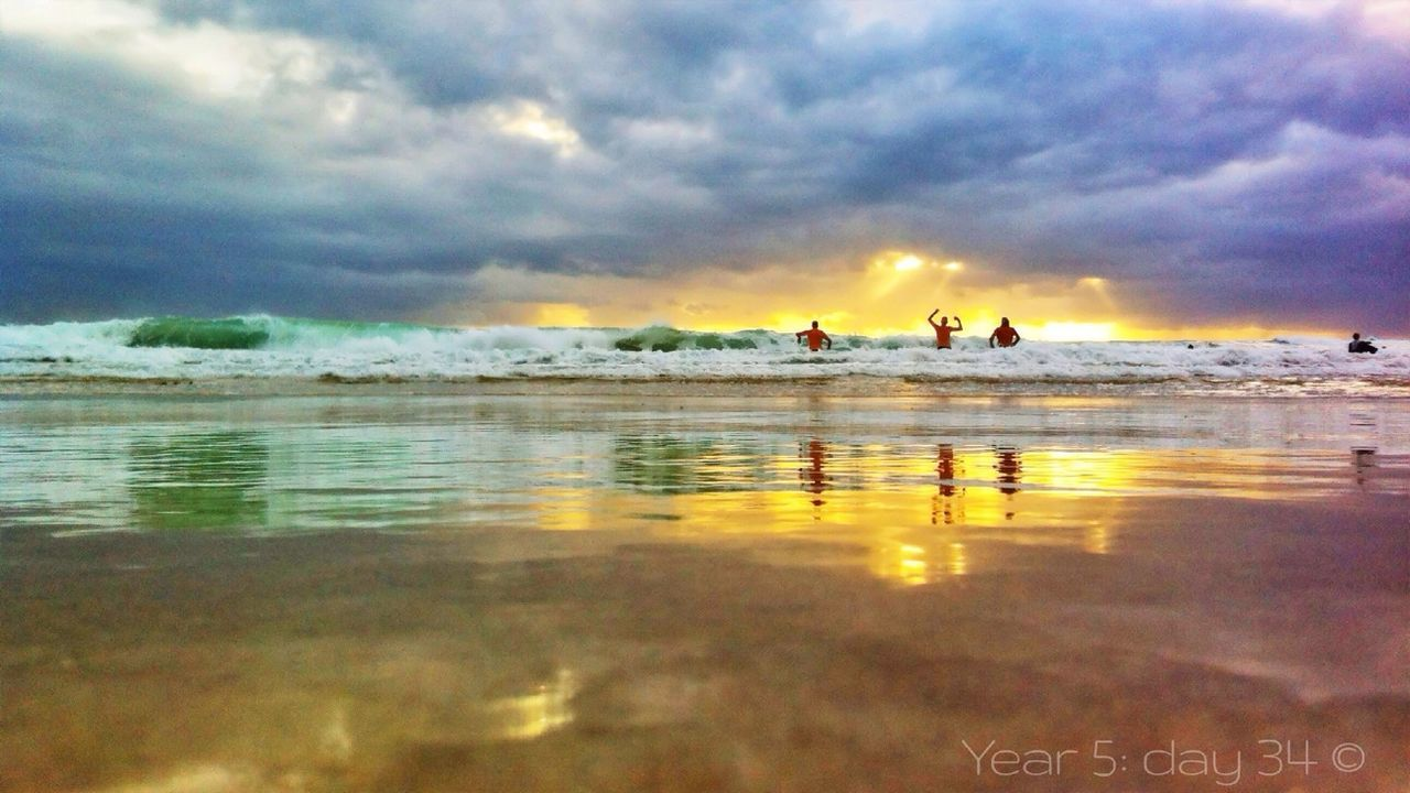 sky, sea, cloud - sky, water, sunset, reflection, beach, nature, scenics, beauty in nature, outdoors, wave, vacations, leisure activity, silhouette, swimming, adventure, men, real people, large group of people, day, horizon over water, bird, people