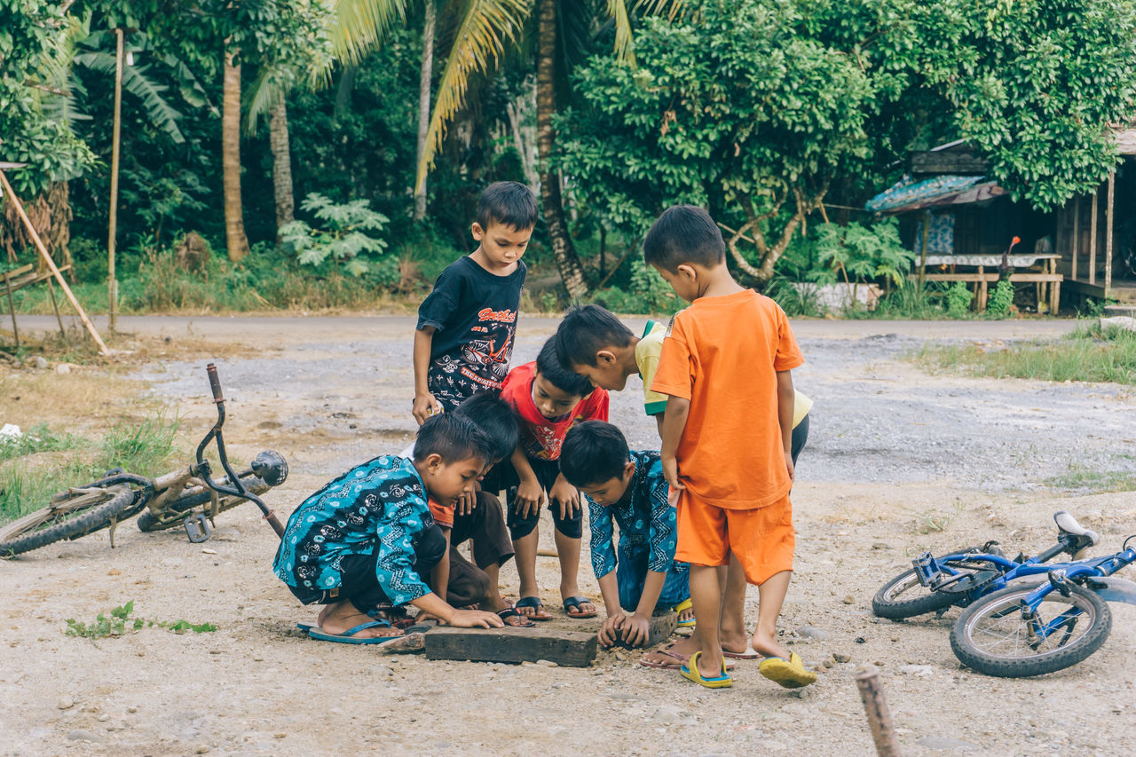Adult Bicycle Boys Child Childhood Crowd Day EyeEmNewHere Family Full Length Looking Males  Men Outdoors People Playing Playing Games Real People Street Photography Togetherness The Street Photographer - 2017 EyeEm Awards