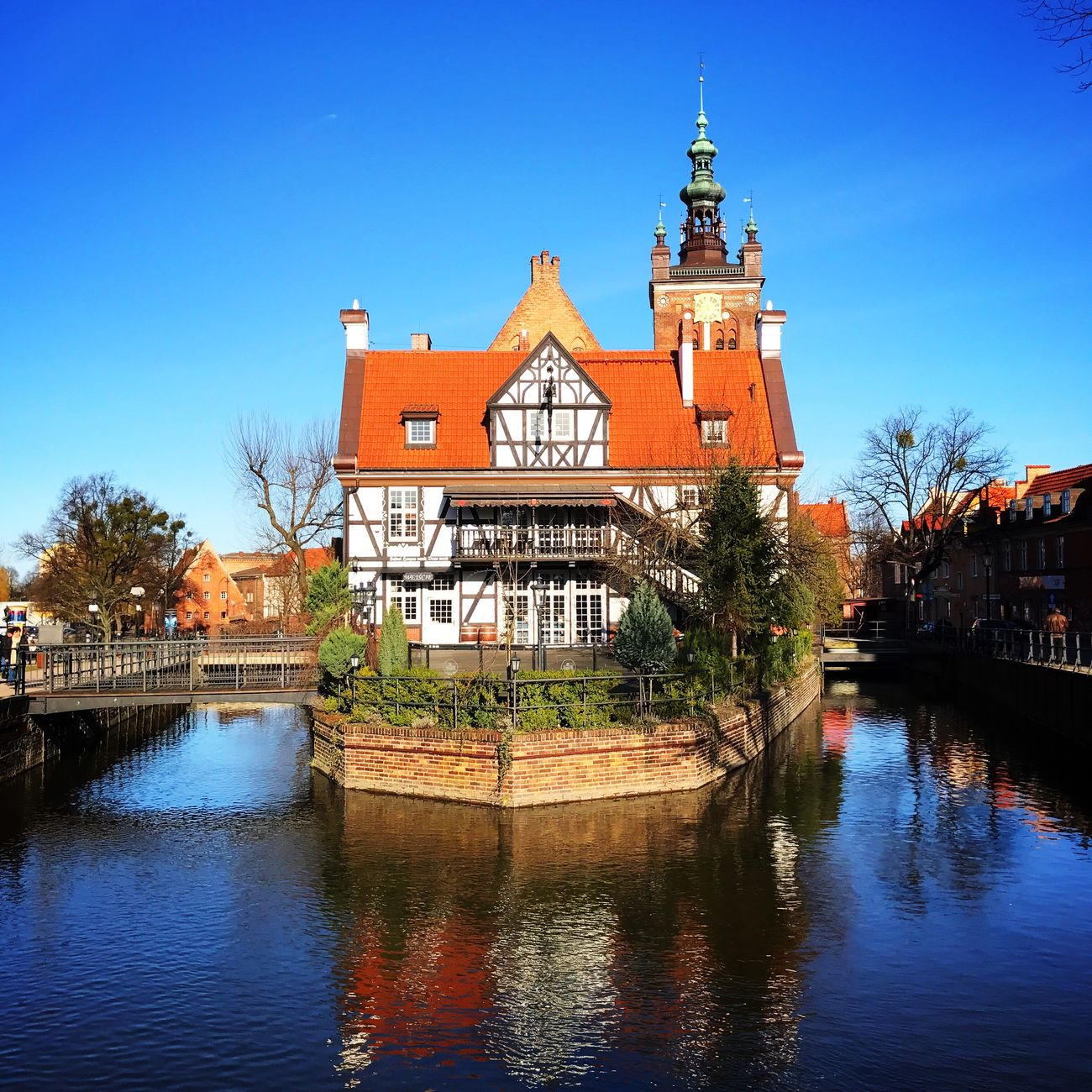 Water Tree Built Structure Architecture River Reflection Building Exterior Waterfront Poland Gdansk Gdansk Clear Sky Outdoors Travel Destinations Sky City Footbridge No People Connection Cultures Day Nature
