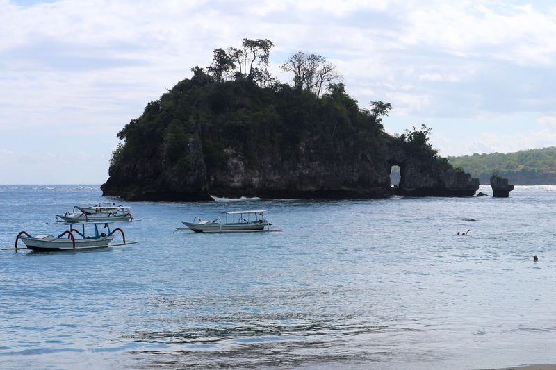 Crystal Bay, Nusa Penida, Bali. Travel Destinations Adventure Exploring Crystal Bay Nusa Penida Bali Boats And Sea Boats Rock Formation Island Tropical Island Island Paradise Paradise Nautical Vessel Water Nature Sea Transportation Sky Mode Of Transport Day Scenics Beauty In Nature Outdoors Tranquility Waterfront Longtail Boat Cloud - Sky Tree No People An Eye For Travel