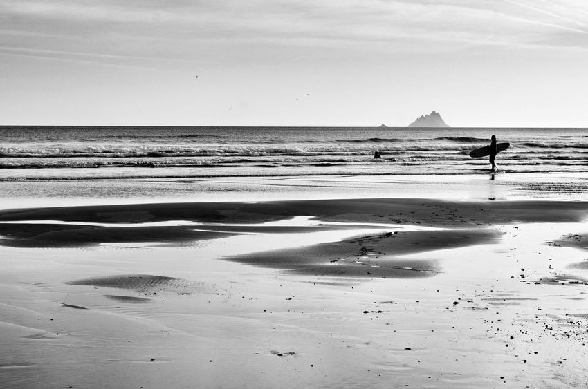 Beach Sea Sand Silhouette One Person Water Horizon Over Water Nature Outdoors Scenics Surf Landscape EyeEmNewHere Blackandwhite Blackandwhite Photography Ireland Ring Of Kerry Skellig Islands