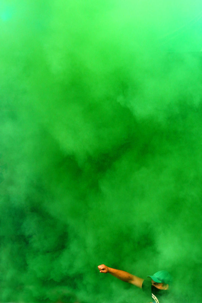 Football fans use pyrotechnics prior to the game. Close-up Fan Fans Fireworks Football Football Fever Green Color Pyrotechnic Pyrotechnics Smoke - Physical Structure Soccer Colour Of Life Color Palette The Color Of Sport