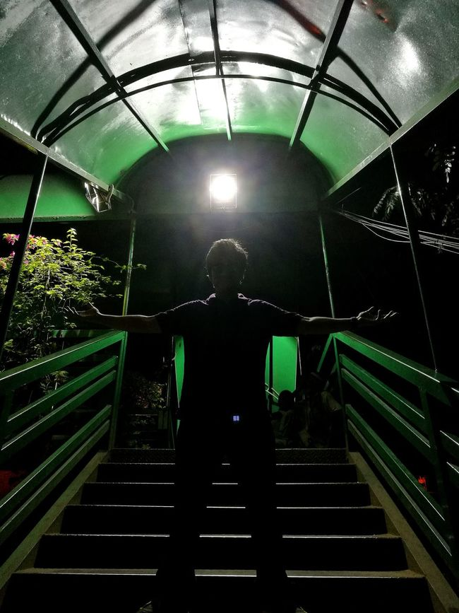 Low Angle View Steps Ceiling Illuminated Steps And Staircases Staircase Railing Back Lit Silhouette Silhouette_collection Man People Urban Tunnel Stairs Standing Dark Darkness And Light Against The Light Overnight Success Taking Photos Power Steps Fine Art Footoverbridge