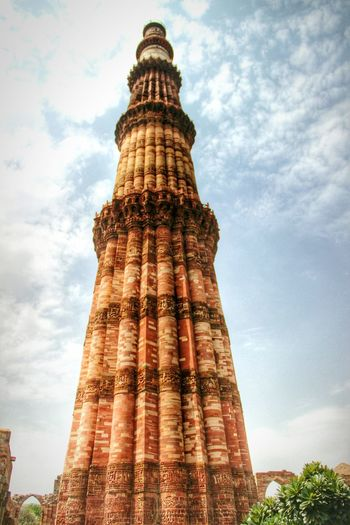 Tallest Brick Minaret of India - Qutab Minar. Built by the Turkish ruler Qutab ud Din Aibak in the 12th Century. Incredible India Monument Newdelhi Medieval Architecture History Blue Sky