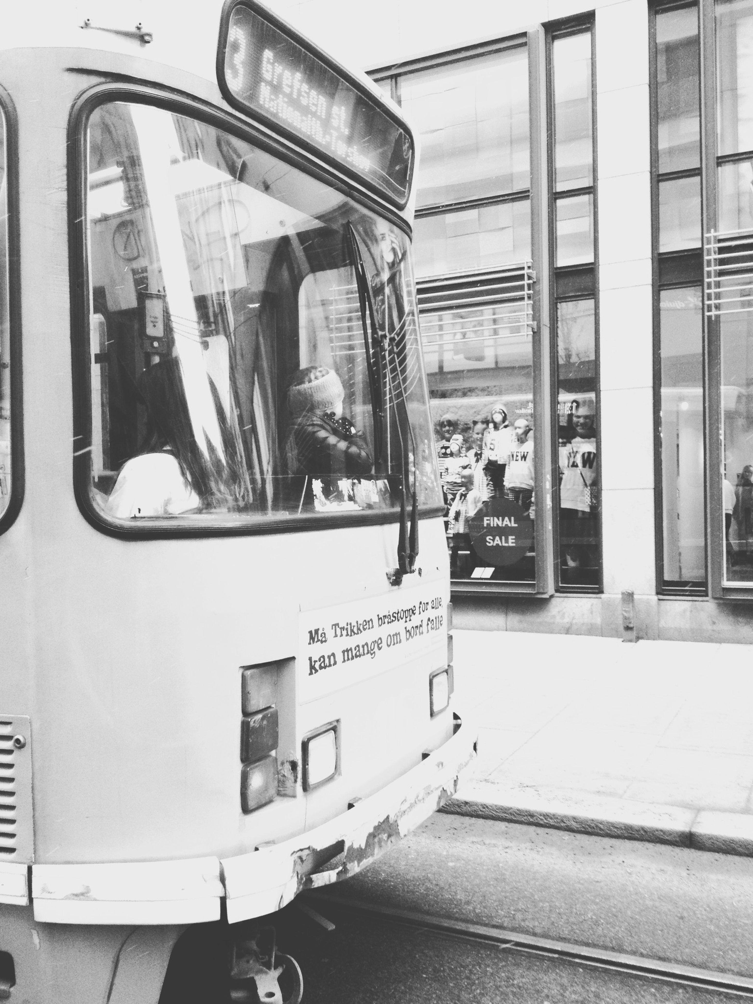 transportation, public transportation, mode of transport, architecture, window, built structure, glass - material, men, land vehicle, building exterior, city, rail transportation, person, train - vehicle, travel, incidental people, railroad station, city life, indoors