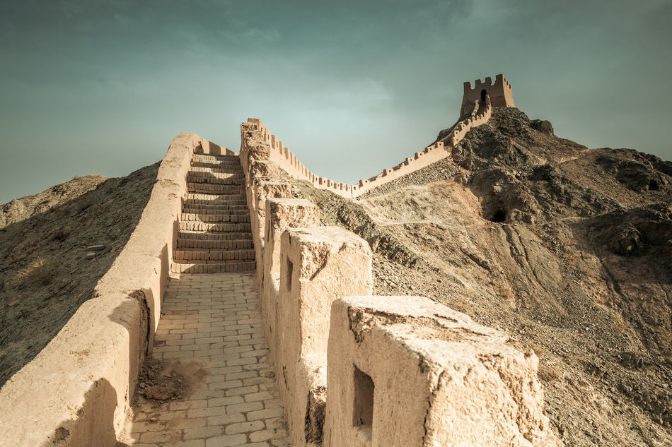 The Great Wall under the Ming Dynasty in Jiayuguan, Gansu China. Ancient Architecture Border Brick China Corridor Culture Defense Famous Fort Great Wall Heritage History Landmark Landscape Ming Dynasty Mountain Protection Rock Sections Sky Structure Tourism Tower Wonder