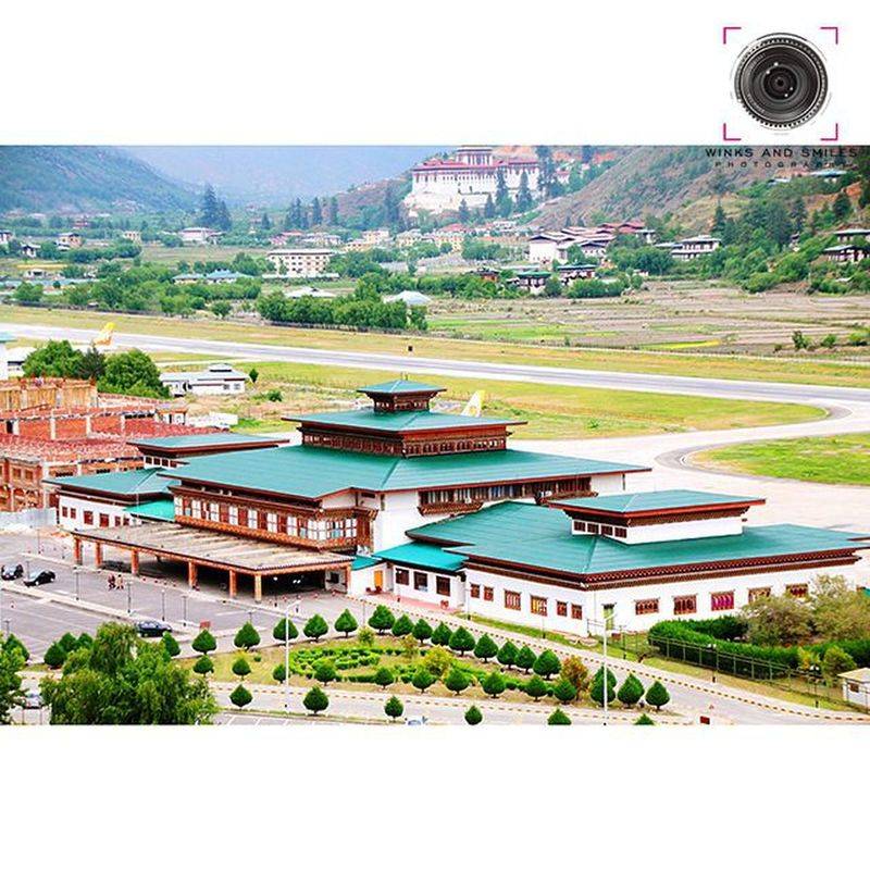 ~~~~~~~~~~~~~~~~~~~~~~~~~~~~~~~~~~~~ 🇬 🇪 🇴 🇲 🇪 🇹 🇷 🇮 🇨🔸🇩 🇪 🇱🇮 🇬 🇭 🇹 ~~~~~~~~~~~~~~~~~~~~~~~~~~~~~~~~~~~ PARO INTERNATIONAL AIRPORT, BHUTAN ✈ ✈ ✈ ✈ ✈ ~~~~~~~~~~~~~~~~~~~~~~~~~~~~~~~~~~~ Paro Airport(PBH) is the soleInternational AirportinBhutan. The airport is located 6km (3.7miles) from Paroin a deep valley on the bank of the riverParo Chhu. With surrounding peaks as high as 18,000ft (5,500m) it is considered one of the world's most challenging airports. AS OF OCTOBER 2009, ONLY EIGHT PILOTS IN THE WORLD WERE CERTIFIED TO LAND AT THE AIRPORT. In 1968, theIndian Border Roads Organisationbuilt anairstrip in theParovalley, which was initially utilised for on call helicopteroperations by theIndian Armed Forceson behalf of Royal Government of Bhutan. Bhutan's first airline,Drukair, was established byRoyal Charteron 5 April 1981. Flights at Paro are allowed undervisual meteorological conditionsonly and are restricted to daylight hours from sunrise to sunset. ~~~~~~~~~~~~~~~~~~~~~~~~~~~~~~~~~~~~ All images are subject to ©copyright No repost, regram or reproduce without prior permission All rights reserved ~~~~~~~~~~~~~~~~~~~~~~~~~~~~~~~~~~~~ Paro Thimphu Bhutan Royalbhutan Bhutanese Royalbhutanairlines Aircraft Travel Travelphotography Indianphotographer Drukair Followforfollows Photographers_of_india Instapic Pod VSCO Natgeotravelpic Natgeotravel Natgeocreative Convexrevolution Ig_bhutan Valley Likeforlikealways Click_india_click Instaairports explorethroughcamera architecture ig_bhutan solotraveler airportsofinstagram