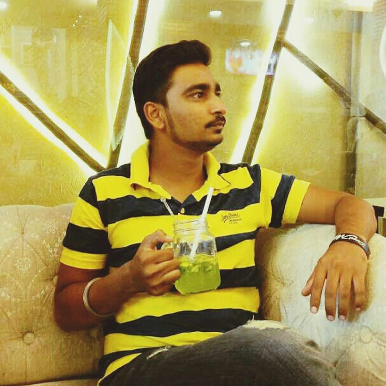 drink, drinking, one person, food and drink, refreshment, sitting, young adult, holding, drinking glass, alcohol, young men, one man only, indoors, front view, leisure activity, real people, water, lifestyles, only men, adults only, day, adult, people