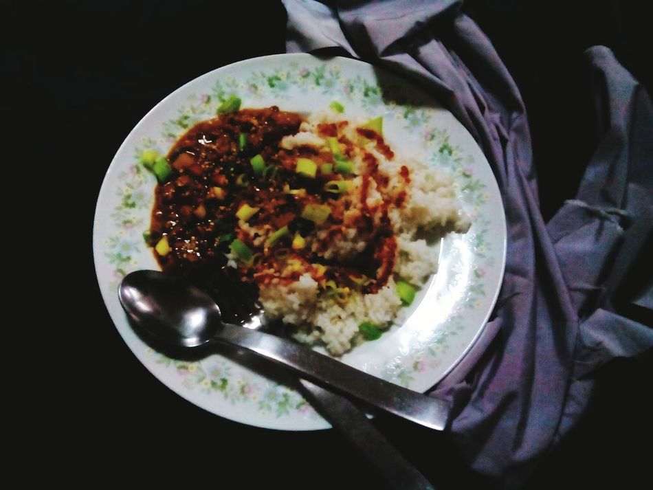 Ground Beef tomato sauce with garbanzos sprinkled with Dukkah and Sriracha. Puredelisciousness Foodphotography Dark Photography Dark Art