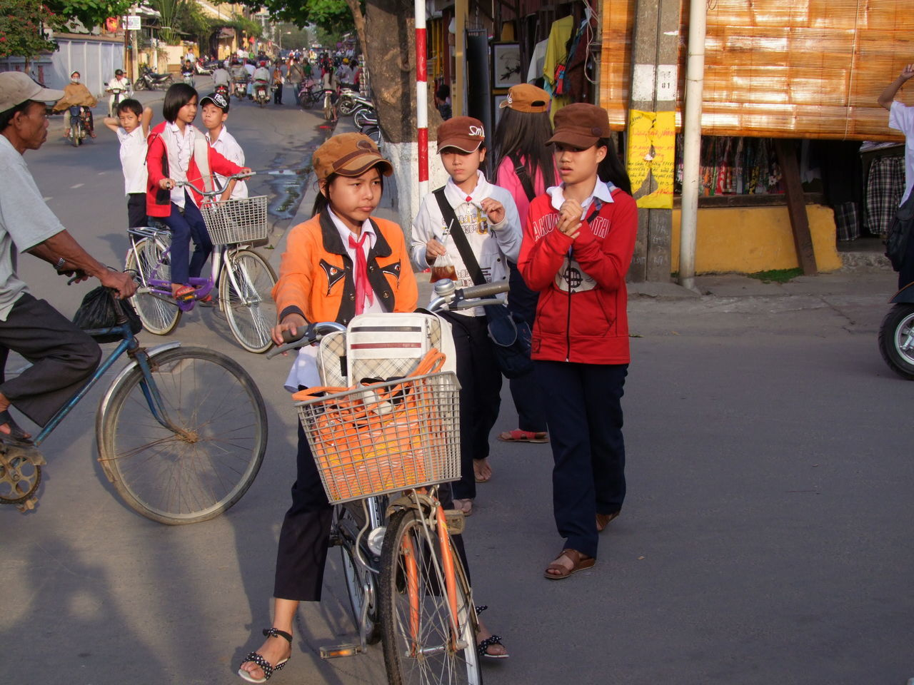 School Children Bicycles City City Life Composition Culture Full Frame Hoi An Leisure Activity Lifestyles On The Way Home Outdoor Photography School Children Street Sunlight And Shadow Traditional Traditional Clothing Uniforms Vietnam