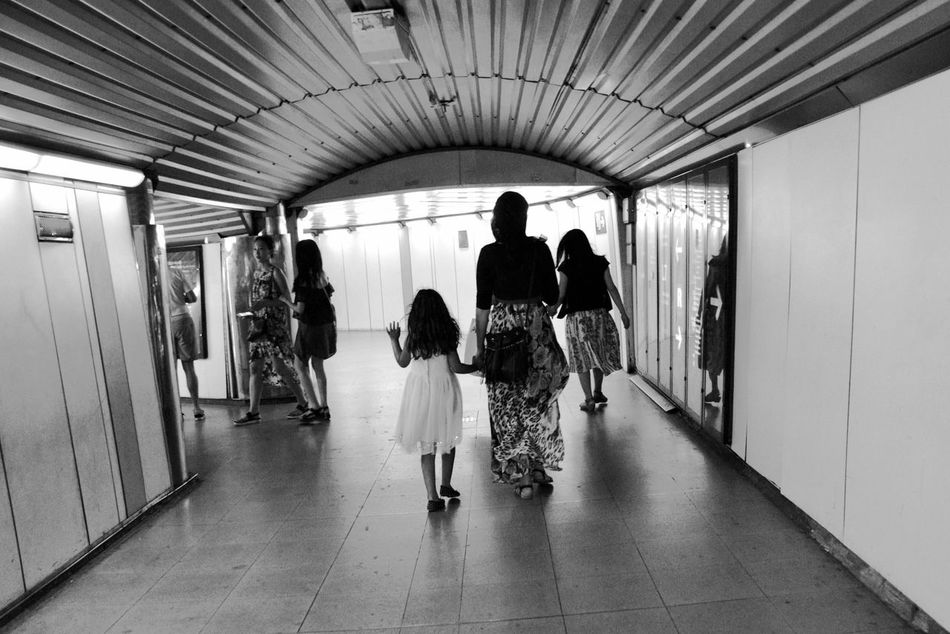Traveling Transportation Subway Subway Station Hidjab Muslim Woman Person Walking Full Length Corridor Narrow The Way Forward City Urban Exploration Metro Station Metro Train Station People Like You And Me Togetherness Family Child Mother Muslim Culture Muslim Mother Religion