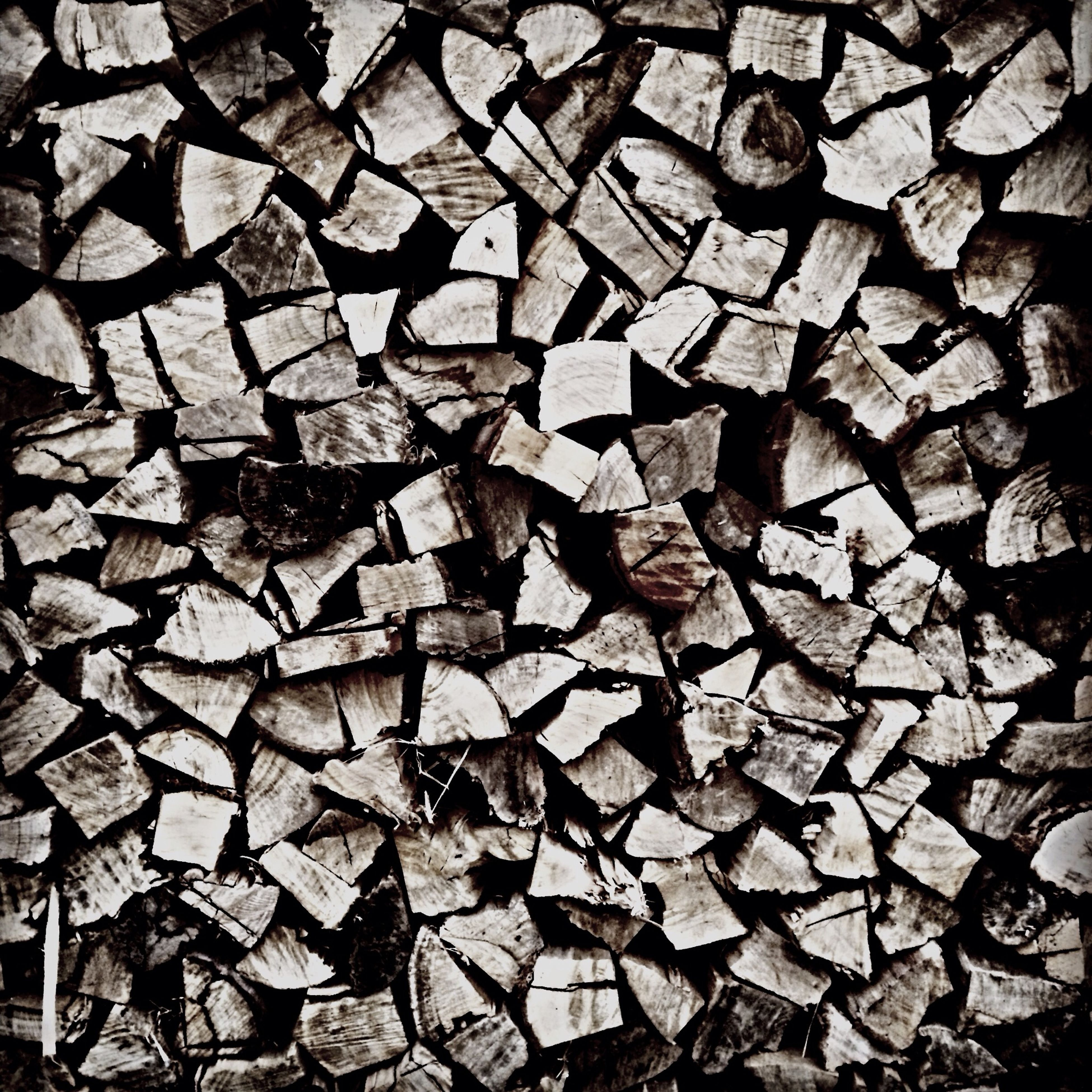 full frame, backgrounds, abundance, large group of objects, pattern, textured, firewood, high angle view, dry, stack, cobblestone, no people, lumber industry, timber, outdoors, day, shape, repetition, deforestation, environmental issues