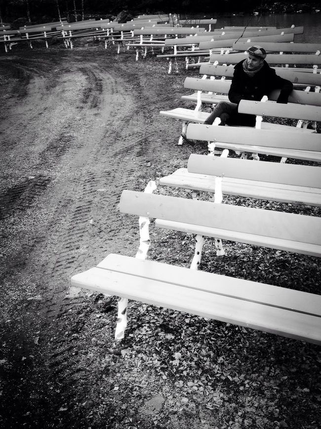Deep in his thoughts among the empty benches Streetphotography AMPt_community Blackandwhite Youmobile