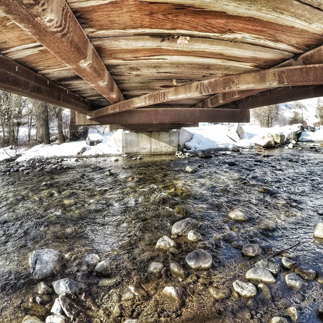Under a bridge No People High Angle View Day Sunlight Outdoors Close-up Full Frame Nature Wet Bridge Water Goprohero5black Bridge - Man Made Structure
