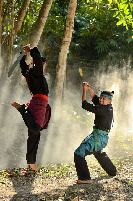 Asian  Break The Mold Day Fight Guru INDONESIA Lifestyles Malaysian Martial Arts Master Nature Outdoors Practicing Real People Self Protection Silat Skill  Sports Clothing Sword Traditional Tree Two People