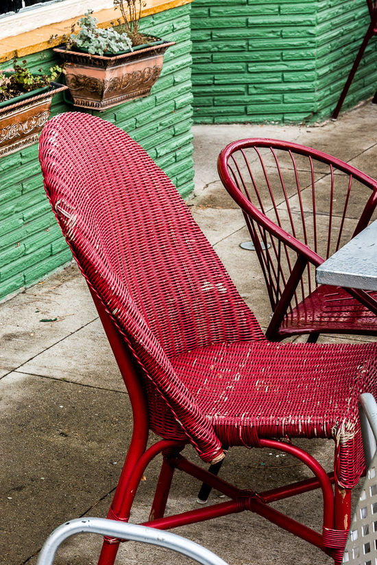 Day Flower Pots Green Bricks Wall No People Outdoors Red Chairs Relaxation Seat Sidewalk Cafe Table